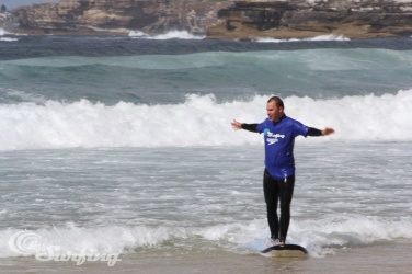 Surfing - at Bondi Beach near my home in Sydney. This photo was taken by the instructor on my first lesson. I've since had a few more and am keeping it up.